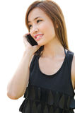 Teen Asian girl using cell phone. Closeup portrait of a cute Asian girl talking on mobile phone Stock Photo