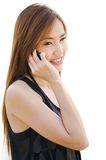 Teen Asian girl using cell phone. Closeup portrait of a cute Asian girl talking on mobile phone Stock Images