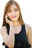 Teen Asian girl using cell phone. Closeup portrait of a cute Asian girl talking on mobile phone Stock Photos