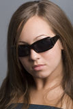 Teen attitude. Portrait of teenage girl wearing sunglasses Stock Photos