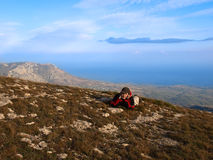 Teen in autumn in the mountains above the sea. Stock Photo