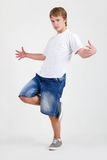 Teen b-boy dancing on white Royalty Free Stock Photos