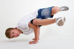 Teen b-boy standing in freeze on white Stock Photography