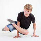 Teen b-boy standing in freeze on white Royalty Free Stock Image