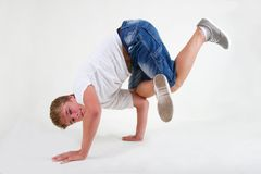 Teen b-boy standing in freeze on white Stock Photo