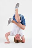 Teen b-boy standing on his head in freeze Royalty Free Stock Photography