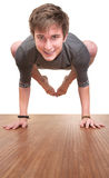 Teen In Bakasana Posture Royalty Free Stock Photo