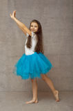 Teen ballerina in a blue tutu with long hair royalty free stock image
