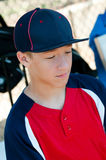Teen Baseball boy in dugout Royalty Free Stock Images