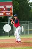 Teen baseball boy ready pitch from the mound. Young little league baseball pitcher about the pitch the ball to batter Stock Images