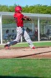 American baseball player swinging bat Stock Photos