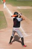 Teen baseball player batting Royalty Free Stock Images