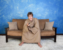 Teen In Bathrobe Watches Television Stock Photography