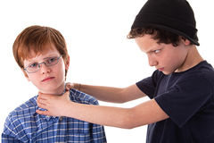 A teen beating a child Royalty Free Stock Images