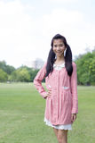 Teen beautiful girl Dress pink happy and relax On Park Royalty Free Stock Photos