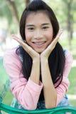 Teen beautiful girl pink shirt Denim Shorts Stock Photo