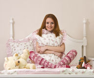 Teen on bed Royalty Free Stock Photo