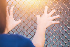 Teen behide the cage or woman jailed Stock Image