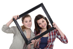 Teen behind black frame Stock Photography