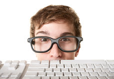Teen Behind Computer Keyboard Stock Images