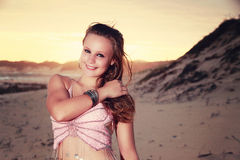 Teen Belly dancer looking shy on the beach Stock Photography