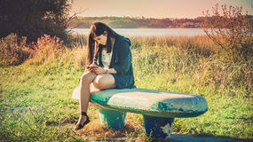 Teen on  the bench Royalty Free Stock Photography