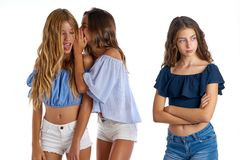 Teen best friends bullying a girl sad apart royalty free stock photos