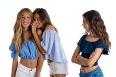 Teen best friends bullying a girl sad apart. Out of the game on white background royalty free stock photography