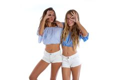 Teen best friends girls happy together. Looking through finger goggles Stock Photos