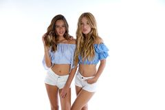 Teen best friends girls happy together. On white background Stock Photo