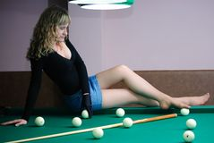 Teen on billiard table Stock Photo