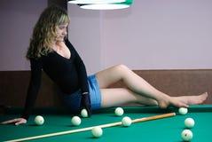 Teen on billiard table Stock Photo