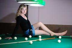 Teen on billiard table Royalty Free Stock Photos