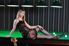 Teen on billiard table Stock Photography