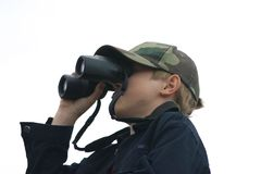 Teen and Binoculars. Teen Using Binoculars. White background Stock Image