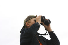 Teen and Binoculars. Teen Using Binoculars. White background Royalty Free Stock Photos