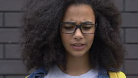 Teen biracial girl suffers teasing about clothes and hair, appearance bullying. Stock footage stock video