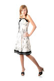 Teen blond girl in elegant white dress Stock Photo