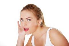 Teen blond woman listening gossip Stock Image