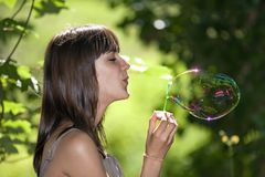 Teen blowing bubble Stock Photo