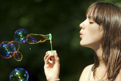 Teen blowing bubbles Royalty Free Stock Image