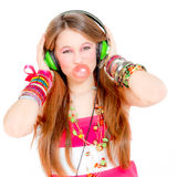 Teen blowing gum listening music