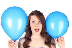 Teen with blue balloons Royalty Free Stock Image