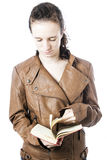 Teen with book. A teen with a book in her hand Royalty Free Stock Images