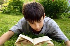 Teen with book. Weekend, garden stock photo