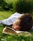 Teen with book. Weekend, garden, teen royalty free stock photos