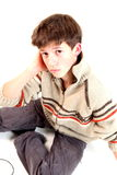 Teen boy. A teen boy and on the floor stock images