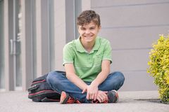 Teen boy back to school. Outdoor portrait of teen boy 14 years old with backpack on the first or last school day. Back to school after vacation royalty free stock photography