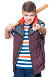 Teen boy with baseball bat. Portrait of a angry teen boy holding a baseball bat and pointing finger to you. Funny hooligan child looking at camera choosing you Royalty Free Stock Photo