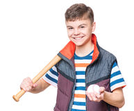 Teen boy with baseball bat. Portrait of a handsome boy teenager holding baseball bat and ball. Funny cute smiling child looking at camera, isolated on white Stock Photos